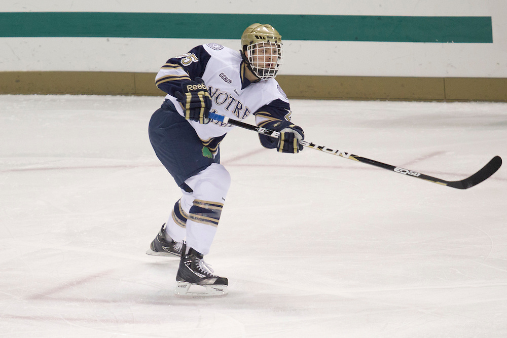 Notre Dame defenseman Kevin Lind (#25) passes the puck in action during NCAA hockey game between Notre Dame and Boston College.  The Notre Dame Fighting Irish defeated the Boston College Eagles 3-2 in game at the Compton Family Ice Arena in South Bend, Indiana.