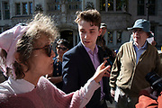 Protesters of different generations from the remain and leave side of the Brexit debate have a discussion outside The Supreme Court as the second day of the hearing to rule on the legality of suspending or proroguing Parliament begins on September 18th 2019 in London, United Kingdom. The ruling will be made by 11 judges in the coming days to determine if the action of Prime Minister Boris Johnson to suspend parliament and his advice to do so given to the Queen was unlawful.