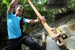 Anshari 45 years  From Balee Village using the large wrench to check on pipes of the gravity flow water system installed by Oxfam almost 9 years ago, following by the Indian Ocean tsunami, Lampuuk village District Aceh Besar, Aceh Province, Sumatra, Indonesia