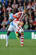 Manchester City's Yaya Toure battles with Stoke's Peter Crouch during the Barclays Premier league match, Stoke city v Manchester city at the Britannia Stadium in Stoke on Trent on Sat 14th Sept 2013. pic by Jeff Thomas, Andrew Orchard sports photography,
