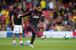 Manchester United's Anthony Martial warming up before the Premier League match at Vicarage Road, Watford