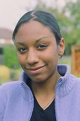 Portrait of teenage girl standing outdoors,