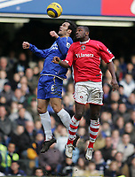 Photo: Lee Earle.<br /> Chelsea v Charlton Athletic. The Barclays Premiership. 22/01/2006. Chelsea's Ricardo Carvalho (L) battles in the air with Darren Bent.