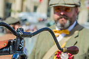 """Penny farthings, some original but mostly new. The Tweed Run 2015 - it's 7th annual British public bicycle ride through London's historic streets, with a prerequisite that participants are dressed in their best tweed cycling attire. There are also plenty of handle bar moustaches, penny farthings and Union Jacks. """"Guests can expect a leisurely day cycling, stopping at some of London's most iconic landmarks to enjoy a spot of tea, a picnic in the park and finally a jolly good knees-up in a beautiful art-deco ballroom for the Tweed Run closing ceremony. Starting at Trafalgar Square, the cyclists then embarked on a 12 mile scenic ride through London, stopping at traditional spots."""