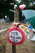 A sign stating that 50% of the fracking wells in Lancashire fail. The poster sits on a post at the Frack Off camp site in Balcombe. Thousands turned out for a march of solidarity against fracking in Balcombe. The village Balcombe in Sussex is the  centre of fracking by the company Cuadrilla. The march saw anti-fracking movements from the Lancashire and the North, Wales and other communities around the UK under threat of gas and oil exploration by fracking.