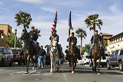 Apr 17, 2017 - Fort Irwin, California, United States - Denim Day Walk. Mounted soldiers ride horses during the 5th annual Denim Day walk at Fort Irwin, Calif., April 17, 2017. Denim Day is an international campaign promoting awareness of sexual assault and harassment. More than 3,000 Fort Irwin soldiers, family members and civilians wore denim jeans and teal-colored shirts as symbols to oppose sexual assault and harassment. Army photo by Pfc. Austin Anyzeski. (Credit Image: ? Austin Anyzeski/DoD via ZUMA Wire/ZUMAPRESS.com)