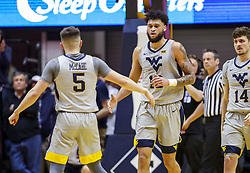 Mar 6, 2019; Morgantown, WV, USA; West Virginia Mountaineers guard Jermaine Haley (10) celebrates with West Virginia Mountaineers guard Jordan McCabe (5) during the first half against the Iowa State Cyclones at WVU Coliseum. Mandatory Credit: Ben Queen-USA TODAY Sports