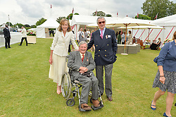 Left to right, the HON.MARK VESTEY, ROSIE VESTEY and ARNAUD BAMBERGER at the Cartier Queen's Cup Final 2016 held at Guards Polo Club, Smiths Lawn, Windsor Great Park, Egham, Surry on 11th June 2016.