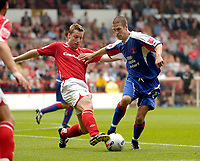 Photo: Leigh Quinnell.<br /> Nottingham Forest v Carlisle United. Coca Cola League 1. 16/09/2006. Forests Neil Harris challenges Carlisles Paul Murray.