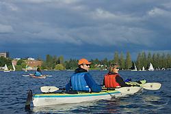 North America, United States, Washington, Seattle, couple kayaking in Montlake Cut near University of Washington MR