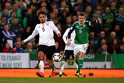 Northern Ireland's Steven Davis (right) and Germany's Mats Hummels during the 2018 FIFA World Cup Qualifying, Group C match at Windsor Park, Belfast.
