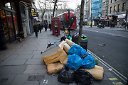 Rubbish left on the street in the West End in London, United Kingdom. Collection of recyclable waste is the city is important business, while doesnt always make the streets look clean.