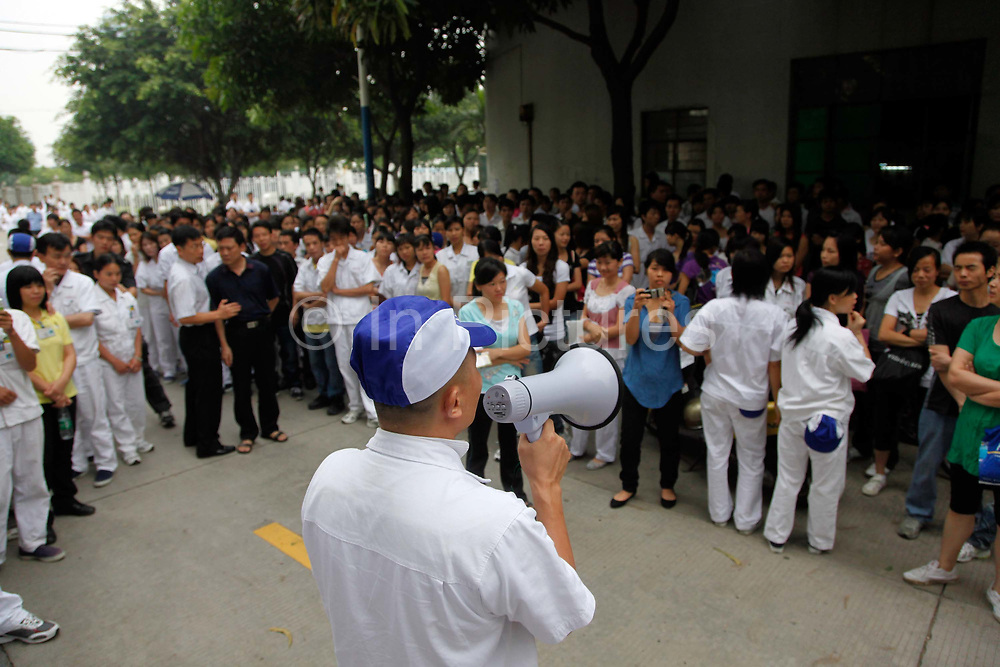 An unidentified manager from the Honda Lock factory tries to persuade workers to go back to the factory in Zhongshan, China on Friday 12 June 2010. China's vast labor force is increasingly using strikes and walkouts as a way to demand higher salary and better compensation with success, many see this as the beginning of the end of China's role as the sweatshop of the world.