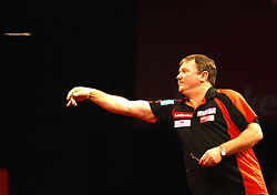 England's Terry Jenkins on his way to beating Co Stompe of the Netherlands to move to the next round in the Darts World Championships at Alexandra Palace, London, Tuesday, Dec.. 27, 2011. photo by morn/I-Images