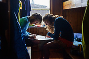 Luke Nelson and Krissy Moehl planning more off-trail adventures, Singi Cabins, Kings Trail, Sweden. day 4