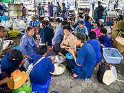 23 NOVEMBER 2012 - BANGKOK, THAILAND:  Members of the Pitak Siam anti-government group cook dinner at their base in Bangkok Friday. Thai authorities have imposed the Internal Security Act (ISA), that enables police to call on the army if needed to keep order, and placed thousands of riot police in the streets around Government House in anticipation of a large anti-government protest Saturday. The group sponsoring the protest, Pitak Siam, said up to 500,000 people could turn out to protest against the government. They are protesting against corruption in the current government and the government's unwillingness to arrest or pursue fugitive former Prime Minister Thaksin Shinawatra, deposed in 2006 coup and later convicted on corruption charges. The current Thai Prime Minister is Yingluck Shinawatra, Thaksin's sister.      PHOTO BY JACK KURTZ