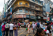 Pedestrians and vendors fill an intersection on 2nd Cross Street in Colombo, Sri Lanka