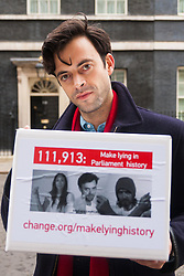 """Downing Street, London, January 7th 2015. TV star 2015-01-07 TV star Jolyon Rubinstein delivers a """"Make Lying in Parliament History"""" petition with 111,913 signatures to 10 Downing Street. The petition aims """"to start a debate about the importance of the truth in politics"""" and comes off the back of his satirical TV show The Revolution Will be Televised which has been """" highlighting the corruption, greed and hypocrisy in our system"""" and wants to make lying in Parliament a criminal offence. PICTURED: Jolyon Rubinstein prepares to deliver the petition."""