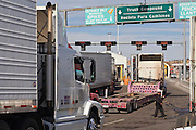 19 DECEMBER 2008 -- NOGALES, SON, MEX: Trucks wait to enter the US on the Mexican side of the Mariposa port of Entry in Nogales.   PHOTO BY JACK KURTZ