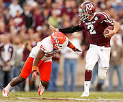 Nov 17, 2012; College Station, TX, USA;  Texas A&M Aggies quarterback Johnny Manziel (2) stiff arms Sam Houston State Bearkats defensive back Mike Littleton (27) during the first half at Kyle Field. Mandatory Credit: Thomas Campbell-US PRESSWIRE