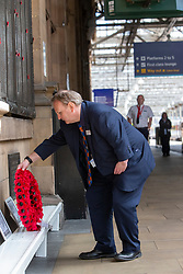 Staff take part in the two minute silence for VE day at the War Memorial at Waverley Station.<br /> Shift Station Manager Bruce Blackie.
