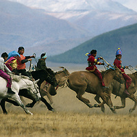 Young riders race bareback at a Naadam festive in the Darhad Valley, Mongolia.