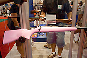 15 MAY 2009 -- PHOENIX, AZ: A pink stocked Czech .22 bolt action rifle at the convention Friday. More than 60,000 people are expected to attend the NRA convention and annual meeting, which is being held at the Phoenix Convention Center through Sunday. This is the 138th annual meeting of the National Rifle Association.  Photo by Jack Kurtz