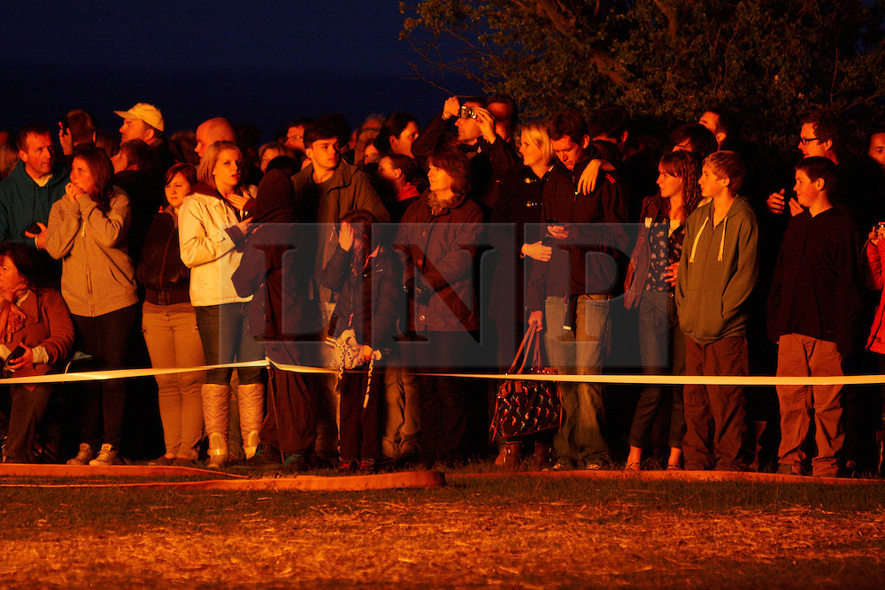© Licensed to London News Pictures. 04/06/2012. WENDOVER, UK. Spectators watch the Jubilee Beacon on Coombe Hill overlooking Chequers near Wendover, Buckinghamshire. The Royal Jubilee celebrations. Great Britain is celebrating the 60th  anniversary of the countries Monarch HRH Queen Elizabeth II accession to the throne this weekend Photo credit : LNP