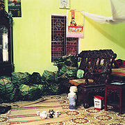 Interior of a house in Thanh Khuc, a village specialising in making Banh Chung, a square glutinous rice cake wrapped in banana leaves, Hanoi, Vietnam. With Vietnam's growing population making less land available for farmers to work, families unable to sustain themselves are turning to the creation of various products in rural areas.  These 'craft' villages specialise in a single product or activity, anything from palm leaf hats to incense sticks, or from noodle making to snake-catching. Some of these 'craft' villages date back hundreds of years, whilst others are a more recent response to enable rural farmers to earn much needed extra income.