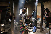 A village woman looks back in a rustic guest house kitchen on May 24, 2008, in Lo Manthang, the capital of Upper Mustang, Nepal. (David Stubbs / Aurora)