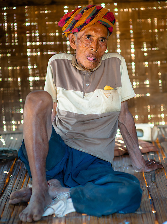 Country old man inside his bamboo house (Myanmar)