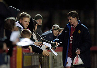 Photo: Jed Wee.<br /> Manchester United Reserves v Bolton Wanderers Reserves.<br /> 15/12/2005.<br /> <br /> Manchester United's Ole Gunnar Solskjaer pauses to sign autographs before leaving.