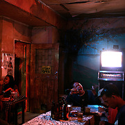 Patrons sing in a karaoke bar on September 21, 2008 in Adriatico Street, Malate, Manila, the Philippines. Karaoke is extremely popular in the Philippines. Photo Tim Clayton