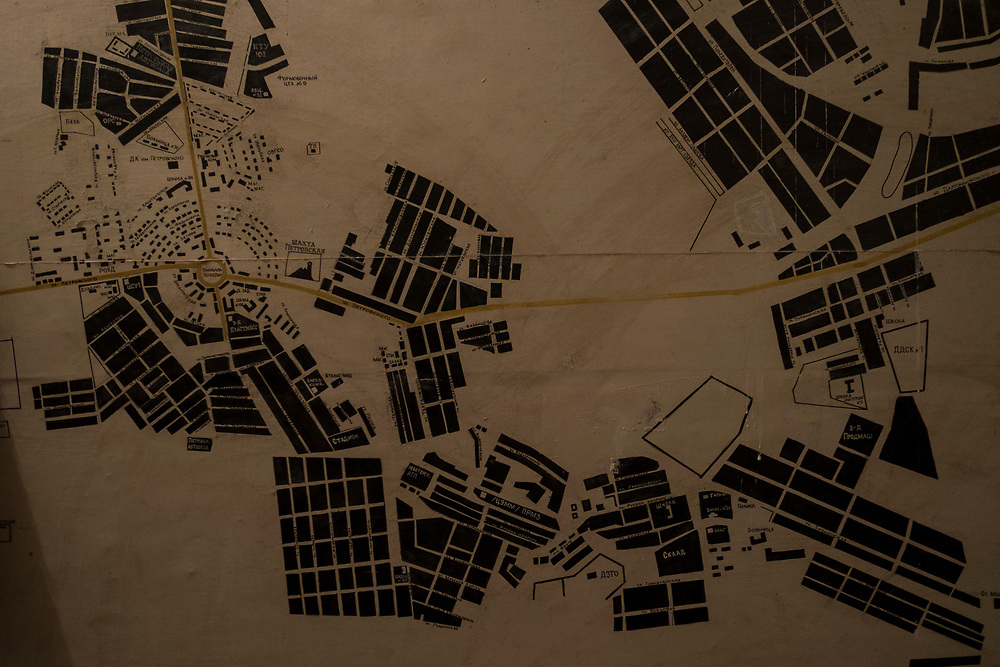 The detailed map of a mining complex is seen on a wall in a Soviet era bomb shelter in Petrovskiy district, Donetsk.