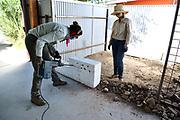 Wall demolition: Underway! Nichole begins the process.