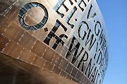 Wales Millennium Centre by Percy Thomas Architects, 2004. Cardiff Bay, Wales Copper oxide coated sheet steel cladding. Calligraphy reads Creu Gwir Fel Gwydr O Ffwrnais Awen (Welsh) In These Stones Horizons Sing (English)