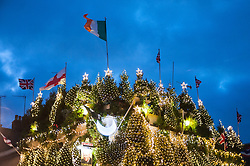 © Licensed to London News Pictures. 04/12/2015. London, UK.  The Christmas lights on the Churchill Arms in Kensington have been switched on.  This year, £30,000 has been spent on decorations including 17,500 lights and 75 trees. In summer, locals enjoy a floral display of hanging baskets. Photo credit : Stephen Chung/LNP