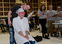 "Lorienne Valovanie dressed for the occasion but still shows apprehension as Ryan Hamel gets ready to ""Pie his Teacher"" at Gilford High School's fundraiser to benefit The Doorway at LRGH on Friday afternoon.  (Karen Bobotas/for the Laconia Daily Sun)"