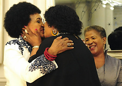 Winnie Madikizela Mandela kisses her daughter Zindzi Mandela at her 80th birthday party on 15 September 2016.