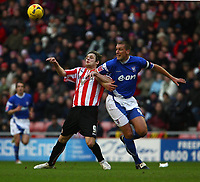 Photo: Andrew Unwin.<br />Sunderland v Ipswich Town. Coca Cola Championship. 13/01/2007.<br />Sunderland's Anthony Stokes (L) tussles with Ipswich's Jason De Vos (R).