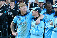 England are World Champions - Eoin Morgan of England and Ben Stokes of England embrace as they wait with the team before the Cricket World Cup trophy lift during the ICC Cricket World Cup 2019 Final match between New Zealand and England at Lord's Cricket Ground, St John's Wood, United Kingdom on 14 July 2019.