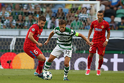 August 15, 2017 - Lisbon, Portugal - Sporting's midfielder Adrien Silva from Portugal (C ) vies with Steaua's midfielder Mihai Pintilii during the UEFA Champions League play-offs first leg football match between Sporting CP and FC Steaua Bucuresti at the Alvalade stadium in Lisbon, Portugal on August 15, 2017. Photo: Pedro Fiuza (Credit Image: © Pedro Fiuza via ZUMA Wire)