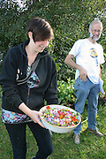 Stephen Barstow and his daughter Hazel, serving salad made from flowers in the garden.