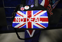 A Brexit supporter wears an Union Jack 'No Deal' handbag during a rally at Featherstone Working Man's Club, while on the European Election in Pontefract, West Yorkshire. Picture dated: Monday May 13, 2019. Photo credit should read: Isabel Infantes / EMPICS Entertainment.