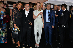 Left to right, OLENA PIRIYEV, NASIB PIRIYEV, NATALIA VODIANOVA and ? at the Chovgan Twilight Polo Gala in association with the PNN Group held at Ham Polo Club, Petersham Close, Richmond, Surrey on 10th September 2014.