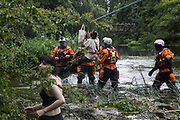 Police officers from Hampshire Police Marine Support Unit detain Swan, an environmental activist from HS2 Rebellion who had been seeking to protect an ancient alder tree from destruction during works for the HS2 high-speed rail link, after she fell from a line which had been cut from the tree during a multi-force policing operation on 24th July 2020 in Denham, United Kingdom. Officers from the Metropolitan Police, Thames Valley Police, City of London Police and Hampshire Police attended to ensure the removal of the tree by HS2 despite protests from activists.