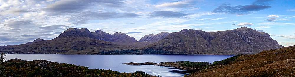 A particularly deep loch, Loch Torridan is bounded on the north by a formidable array of steep, high mountains.