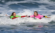 Anna Brock and Ava Henderson. U18 Girls.<br /> Surfing New Zealand National Championships 2021. Piha Beach, Auckland, New Zealand. Tuesday 12 January 2021.<br /> © image by Andrew Cornaga / www.Photosport.nz