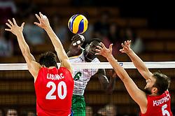 07.09.2014, Centennial Hall, Breslau, POL, FIVB WM, Serbien vs Kamerun, Gruppe A, im Bild Srecko Lisinac serbia #20 Sem Dolegombai cameroon #6 Vlado Petkovic serbia #5 // Srecko Lisinac serbia #20 Sem Dolegombai cameroon #6 Vlado Petkovic serbia #5 // during the FIVB Volleyball Men's World Championships Pool A Match beween Serbia and Cameroon at the Centennial Hall in Breslau, Poland on 2014/09/07.<br /> <br /> ***NETHERLANDS ONLY***