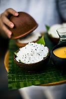 Coconut flesh and black sesame seeds at the Six Senses Resort. The shredded coconut is the base of the spa's signature body scrub.